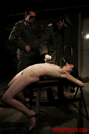Slim broad in the nude gets the hot and cold treatment from her interrogators. - XXXonXXX - Pic 5