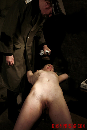 Slim broad in the nude gets the hot and cold treatment from her interrogators. - XXXonXXX - Pic 7