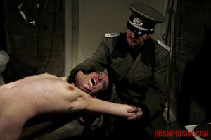 Slim broad in the nude gets the hot and cold treatment from her interrogators. - XXXonXXX - Pic 10