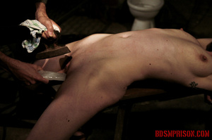 Slim broad in the nude gets the hot and cold treatment from her interrogators. - XXXonXXX - Pic 11