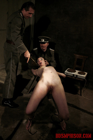 Slim broad in the nude gets the hot and cold treatment from her interrogators. - XXXonXXX - Pic 13