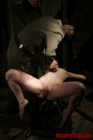 Slim broad in the nude gets the hot and cold treatment from her interrogators. - XXXonXXX - Pic 14