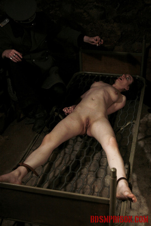 Bare honey tied to a stripped bed feels the heat from her guard's cigarettes. - XXXonXXX - Pic 10