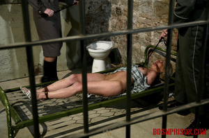 Gagged blonde in a plaid dress gets inspected by some uniformed guards. - XXXonXXX - Pic 3