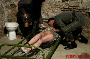 Gagged blonde in a plaid dress gets inspected by some uniformed guards. - XXXonXXX - Pic 4