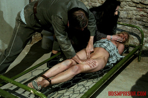 Gagged blonde in a plaid dress gets inspected by some uniformed guards. - XXXonXXX - Pic 6