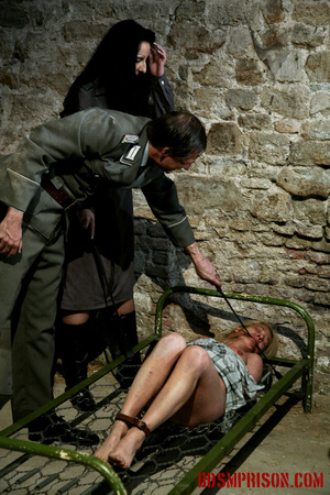 Gagged blonde in a plaid dress gets inspected by some uniformed guards. - XXXonXXX - Pic 10