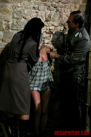 Gagged blonde in a plaid dress gets inspected by some uniformed guards. - XXXonXXX - Pic 15
