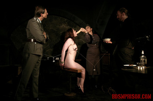 Seated naked chick gets her nipples clamped, weights are hung and then fed with a dildo. - XXXonXXX - Pic 14