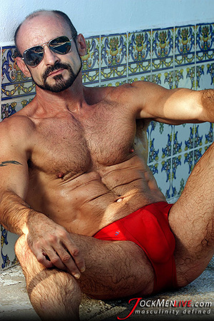 Muscular hung with a beard posing in red undershorts and showing his long dong - XXXonXXX - Pic 2