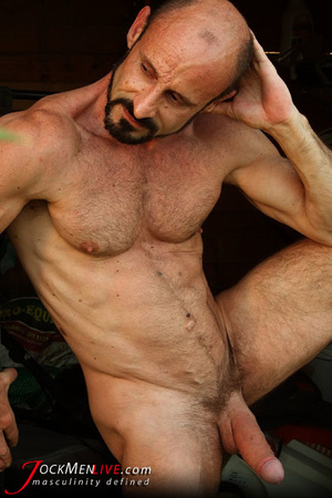 Muscular hung with a beard posing in red undershorts and showing his long dong - XXXonXXX - Pic 3