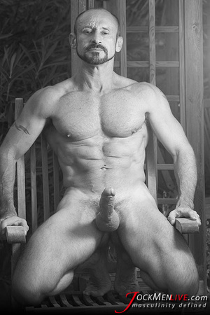 Muscular hung with a beard posing in red undershorts and showing his long dong - XXXonXXX - Pic 5