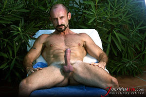 Muscular hung with a beard posing in red undershorts and showing his long dong - XXXonXXX - Pic 6