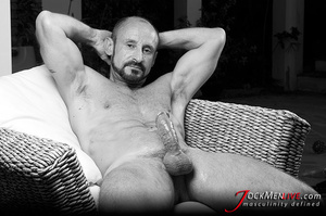 Muscular hung with a beard posing in red undershorts and showing his long dong - XXXonXXX - Pic 12