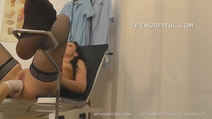 Sexy brunette takes off her black panty and spreads her legs on a black seat wearing black stockings then lets her doctor examine her pussy as he insert different tools inside it. - XXXonXXX - Pic 10