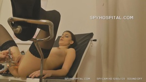 Luscious babe strips off her black panty then lets her doctor slip different tools in her crack as she opens her legs wide on a black chair wearing her black stockings in a hospital. - XXXonXXX - Pic 2