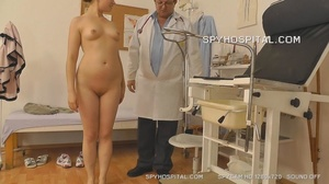 Luscious chick takes off her black and pink skirt then bends over on a white hospital bed while her doctor checks out her ass then he makes her squat naked on the floor before she lets him plant a glass speculum in her pussy then fingers it on a black seat. - XXXonXXX - Pic 12