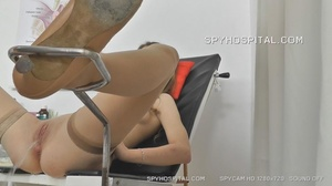 Skinny chick peels off her black lingerie then sits and pisses on a black seat before she lets her doctor drill a metal speculum and a plastic tube in her crack. - XXXonXXX - Pic 2