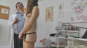Skinny chick peels off her black lingerie then sits and pisses on a black seat before she lets her doctor drill a metal speculum and a plastic tube in her crack. - XXXonXXX - Pic 3