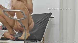 Skinny chick peels off her black lingerie then sits and pisses on a black seat before she lets her doctor drill a metal speculum and a plastic tube in her crack. - XXXonXXX - Pic 4