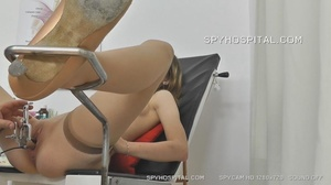 Skinny chick peels off her black lingerie then sits and pisses on a black seat before she lets her doctor drill a metal speculum and a plastic tube in her crack. - XXXonXXX - Pic 5
