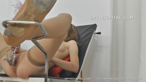 Skinny chick peels off her black lingerie then sits and pisses on a black seat before she lets her doctor drill a metal speculum and a plastic tube in her crack. - XXXonXXX - Pic 8