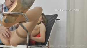 Skinny chick peels off her black lingerie then sits and pisses on a black seat before she lets her doctor drill a metal speculum and a plastic tube in her crack. - XXXonXXX - Pic 12