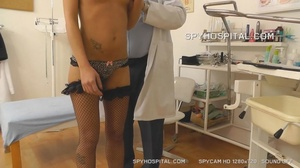 Sexy babe takes off her black and white panty then opens her legs wide on a gray seat wearing her black fishnet stockings then she lets her doctor drill different tools in her pussy and ass. - XXXonXXX - Pic 11