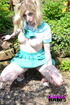 Pigtailed girl in anime cosplay amusing with a…