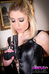 Curvy blonde chick in a cosplay and with a toy gun…