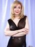 Hot light blonde mama in transparent long black dress shows hot curves