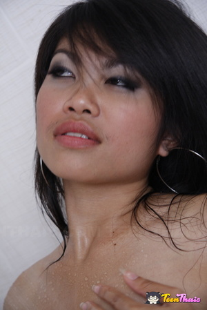 Naked Asian babe gets her sexy body wet while taking a shower then she rubs soap in her ass before she lets another hot Thai join her then she gives her a shower before they make out in the bathroom. - XXXonXXX - Pic 4