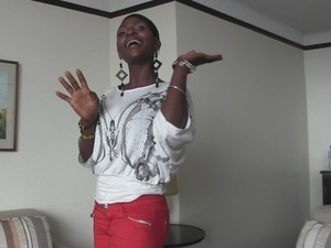 Alluring African chick takes off her white blouse with gray design and bares her huge tits wearing her pink pants then she goes down and sucks a huge cock before she rides on it. - XXXonXXX - Pic 6