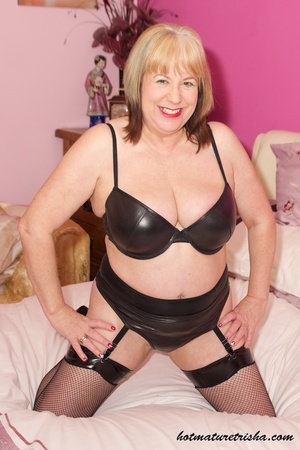Fat MILF in black lingerie stockings and high heels takes off her bra and displays her huge mature breasts on a white bed before she pulls down her panty, bends over and shows her nasty pussy. - XXXonXXX - Pic 2