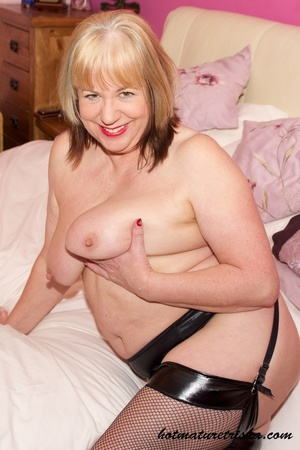Fat MILF in black lingerie stockings and high heels takes off her bra and displays her huge mature breasts on a white bed before she pulls down her panty, bends over and shows her nasty pussy. - XXXonXXX - Pic 10