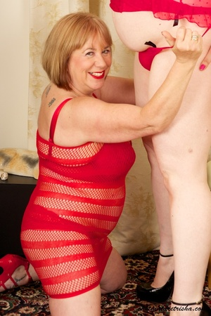 Two mature blondes in red lingerie licks each others old breasts on a white and brown chair. - XXXonXXX - Pic 11