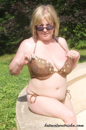 Mature hottie with sunglasses unstrings her sparkling golden brown bikini then displays her fat body with big soggy boobs outdoor. - XXXonXXX - Pic 7