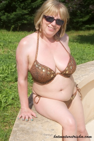 Mature hottie with sunglasses unstrings her sparkling golden brown bikini then displays her fat body with big soggy boobs outdoor. - XXXonXXX - Pic 8