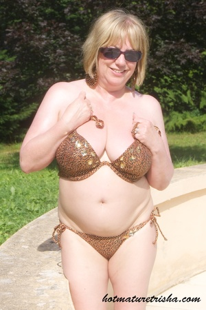 Mature hottie with sunglasses unstrings her sparkling golden brown bikini then displays her fat body with big soggy boobs outdoor. - XXXonXXX - Pic 9