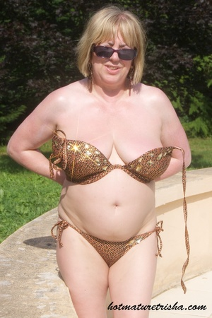 Mature hottie with sunglasses unstrings her sparkling golden brown bikini then displays her fat body with big soggy boobs outdoor. - XXXonXXX - Pic 10