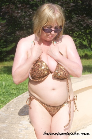 Mature hottie with sunglasses unstrings her sparkling golden brown bikini then displays her fat body with big soggy boobs outdoor. - XXXonXXX - Pic 11