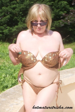Mature hottie with sunglasses unstrings her sparkling golden brown bikini then displays her fat body with big soggy boobs outdoor. - XXXonXXX - Pic 12