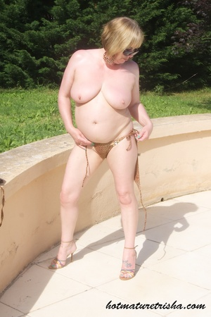 Mature hottie with sunglasses unstrings her sparkling golden brown bikini then displays her fat body with big soggy boobs outdoor. - XXXonXXX - Pic 15