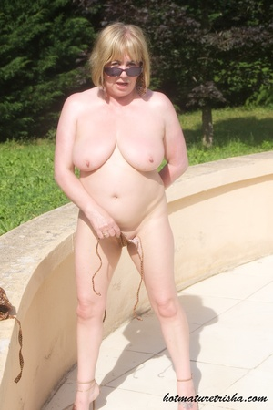 Mature hottie with sunglasses unstrings her sparkling golden brown bikini then displays her fat body with big soggy boobs outdoor. - XXXonXXX - Pic 16