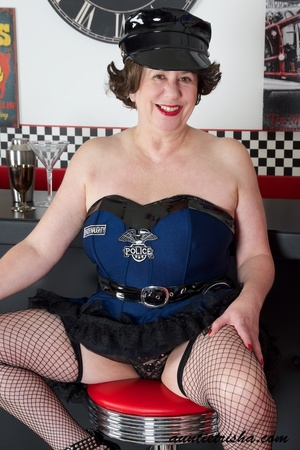 Hot granny wearing black hat, blue and black dress, black panty, fishnet stockings and high heels displays her fat body before she takes off her dress. - XXXonXXX - Pic 4