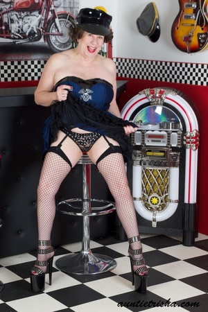 Hot granny wearing black hat, blue and black dress, black panty, fishnet stockings and high heels displays her fat body before she takes off her dress. - XXXonXXX - Pic 5