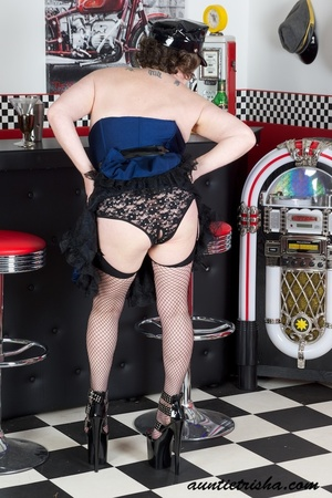 Hot granny wearing black hat, blue and black dress, black panty, fishnet stockings and high heels displays her fat body before she takes off her dress. - XXXonXXX - Pic 7