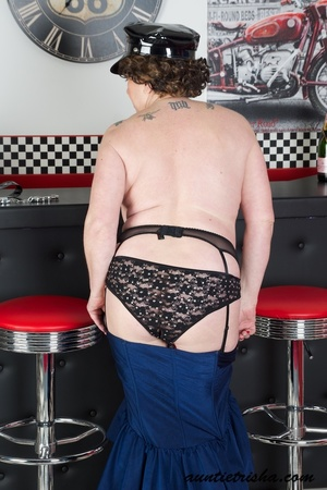 Hot granny wearing black hat, blue and black dress, black panty, fishnet stockings and high heels displays her fat body before she takes off her dress. - XXXonXXX - Pic 13