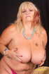 Mature blonde displays her huge body in violet…