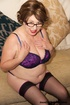 Mature chick with glasses strips off her colorful…